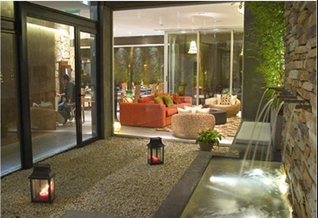 Mine hotel boutique arqa for Decoracion patios interiores