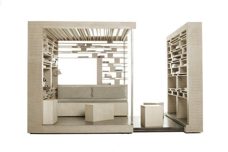 production cube # 01, 2009, 250x250x250/450 cm, plywood and books