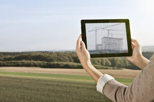 Architect using digital tablet