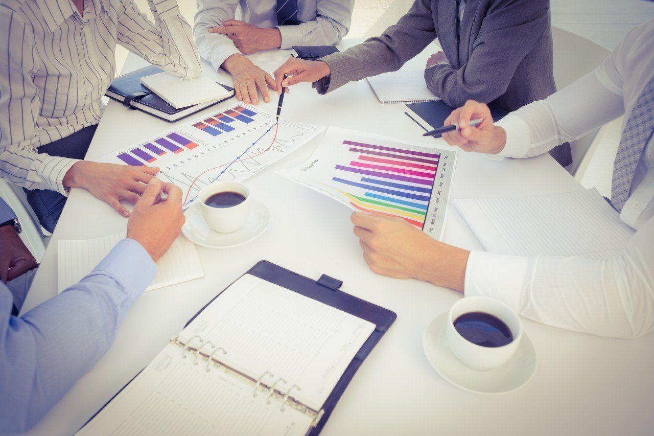 14 Mar 2015 --- Business team analyzing bar chart graphs --- Image by © Wavebreakmedia LTD/Wavebreak Media Ltd./Corbis